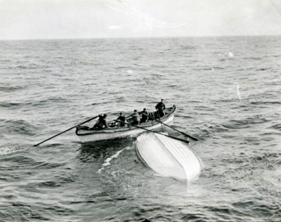 A life boat waiting to be taken aboard rescue ship RMS Carpathia near a capsized life boat